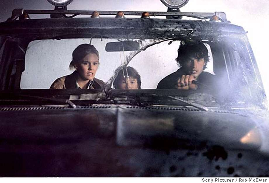"In this photo provided by Sony Pictures ,Elizabeth Williams ( Maggie Grace), Andy Wayne (Cole Heppell) , Nick Castle (Tom Welling) tries to escape a thick fog that enshrouds their town in ""The Fog."" (AP Photo/Sony Pictures/Rob McEwan) Photo: Sony Pictures"