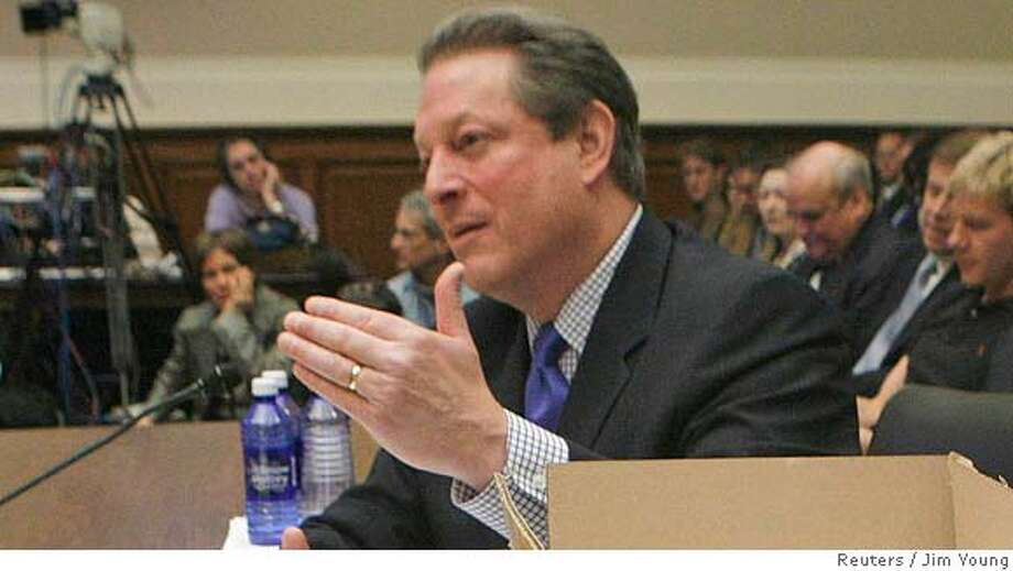 Former U.S. Vice President Al Gore testifies before the House Energy & Air Quality Subcommittee and Science & Technology Energy & Environment Subcommittee joint hearing on climate change, on Capitol Hill in Washington, March 21, 2007. On Gore's left are boxes of letters calling on Congress to take action on global warming. REUTERS/Jim Young (UNITED STATES) 0 Photo: JIM YOUNG