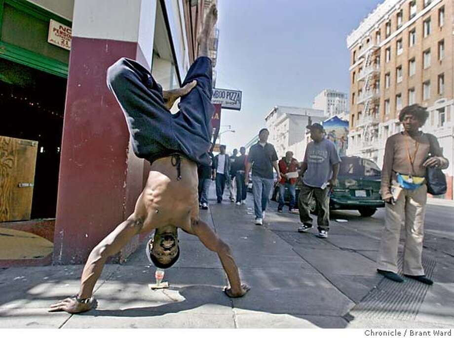 "homelessmovie074_ward.jpg  Theo White, a homeless man, often performs his yoga on the streets of San Francisco to make a little money...he was seen by the film people who invited him to be an extra in the movie.  A new movie being shot in the Tenderloin district of San Francisco is called ""The Pursuit of Happiness."" It stars Will Smith as a homeless man who becomes a success. Over 200 homeless people have been hired as extras for the film which is being shot in and around Glide Memorial Church.  10/6/05 Photo: Brant Ward"