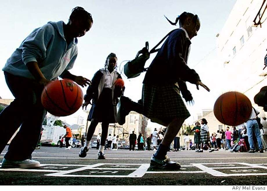 Students play in the school yard as they wait to begin their first day of school at Cathedral Academy Monday, Oct. 17, 2005 in New Orleans, La. The Catholic Elementary School is the first school to reopen in the French Quarter since Hurricane Katrina hit the area. (AP photo/Mel Evans) Photo: MEL EVANS