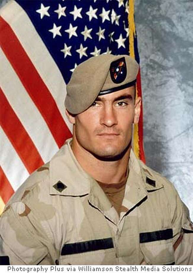 ** FILE ** Former Arizona Cardinals football player Pat Tillman, is shown in a June 2003 file photo, released by Photography Plus. Investigators probing the friendly fire death in Afghanistan of former football star Pat Tillman found no criminal negligence, a government official said Monday, March 26, 2007. (AP Photo/Photography Plus via Williamson Stealth Media Solutions, FILE) ** NO SALES ** PHOTOGRAPHY PLUS VIA WILLIAMSON STEALTH MEDIA SOLUTIONS, NO SALES 2003 FILE PHOTO Photo: Photography Plus Via Williamson