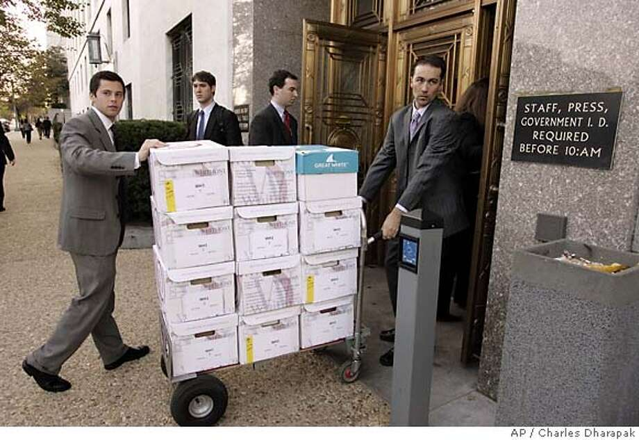 Congressional staff members push a cart of boxes containing questionnaires answered by Supreme Court nominee Harriet into the Dirksen Senate Office building to be delivered to the Senate Judiciary Committee on Capitol Hill Tuesday, Oct. 18, 2005 in Washington. Supreme Court nominee Harriet believes the Constitution contains a right to privacy, senators say, but she has not told anyone where she stands on the Roe v. Wade ruling that established abortion rights. (AP Photo/Charles Dharapak) Photo: CHARLES DHARAPAK