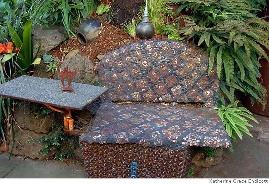 Mosaic seat in Scott Melcher's garden, which will be on the Park Day School Secret Gardens tour April 29. Credit: Ron Sullivan Photo: Ron Sullivan
