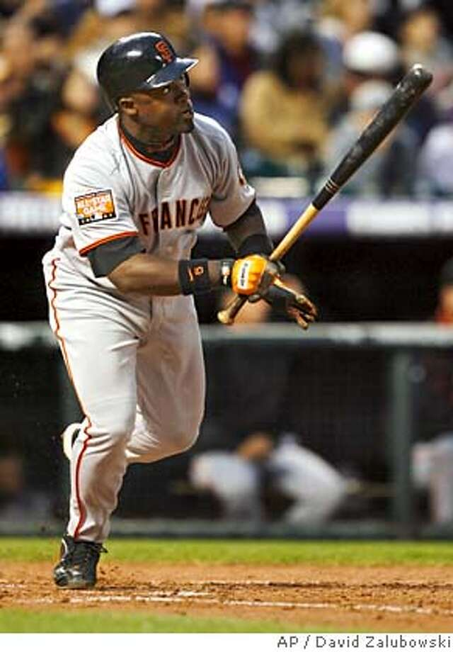 San Francisco Giants' Ray Durham follows the flight of his three-run home run off Colorado Rockies starting pitcher Jeff Francis in the third inning of a baseball game in Denver on Monday, April 16, 2007. (AP Photo/David Zalubowski) Photo: David Zalubowski