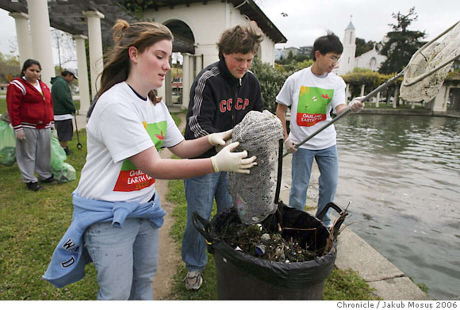 CW_Earthday_Oakland_01_JMM.JPG Volunteers Rachel Noecker, 14 of Livermore, Alex Boag, 15 of Pleasanton, and Shelton Tso, 16 of Fremont, dispose of trash fished out of Lake Merritt during Earth Day on Saturday April 22, 2006.  Event on 4/22/06 in Oakland. JAKUB MOSUR / The ChronicleRan on: 04-26-2006  Ran on: 04-26-2006  Ran on: 04-26-2006  Ran on: 04-26-2006  Ran on: 04-26-2006 Photo: JAKUB MOSUR