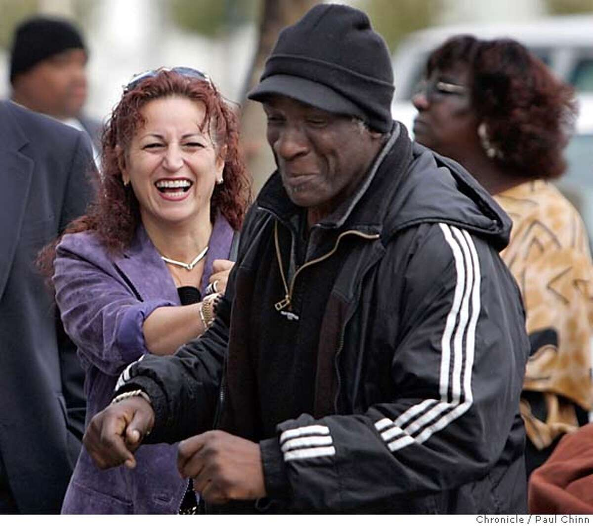 homeless19_052_pc.jpg Angela Alioto, who authored the city's ten-year plan to end chronic homelessness, laughs with Rocky McGriff, as he danced while waiting in line for services. Several hundred people waited in line for several hours at the Bill Graham Civic Auditorium for social assistance at the bi-monthly Project Homeless Connect program on 10/18/05 in San Francisco, Calif. PAUL CHINN/The Chronicle MANDATORY CREDIT FOR PHOTOG AND S.F. CHRONICLE/ - MAGS OUT