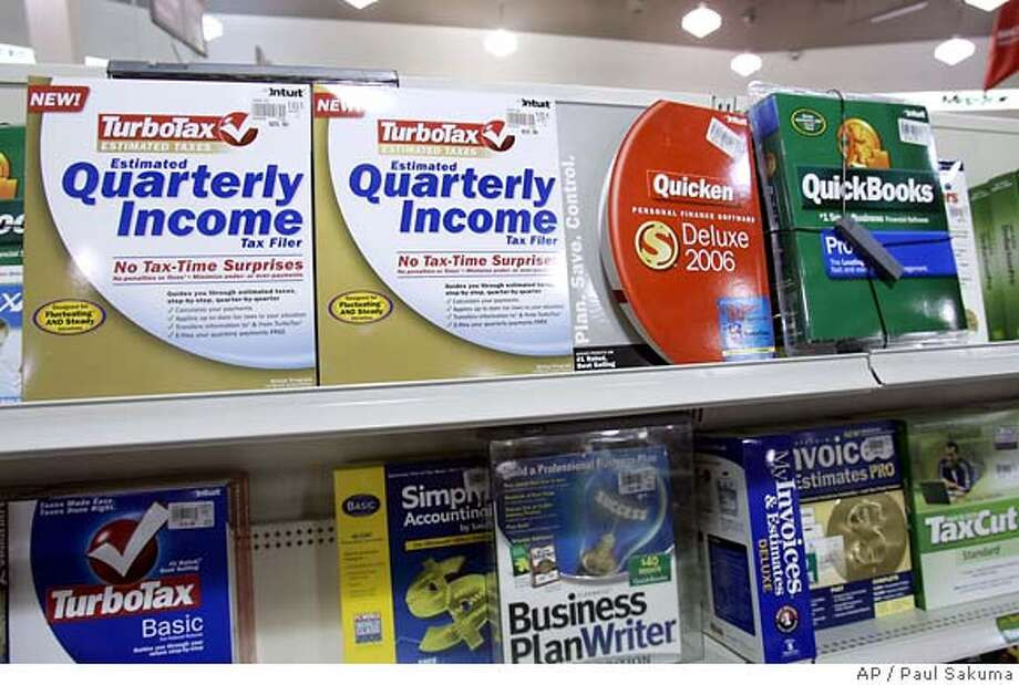 **FILE** Intuit software TurboTax, Quicken and QuickBooks on sale at Micro Center computer store in Santa Clara, Calif., in this Monday, Feb. 13, 2006 file photo. The company that makes the popular TurboTax and ProSeries tax software said it expects to hear from the IRS whether any taxpayers who used its swamped e-filing system would be penalized for submitting late returns. A flood of last-minute tax filers overwhelmed servers of Intuit Inc. on Tuesday, April 17, 2007, causing hours-long delays in getting forms sent in electronically to the government, said Harry Pforzheimer, a spokesman for the Mountain View-based company. (AP Photo/Paul Sakuma, file) FEB. 13, 2006 FILE PHOTO Photo: PAUL SAKUMA