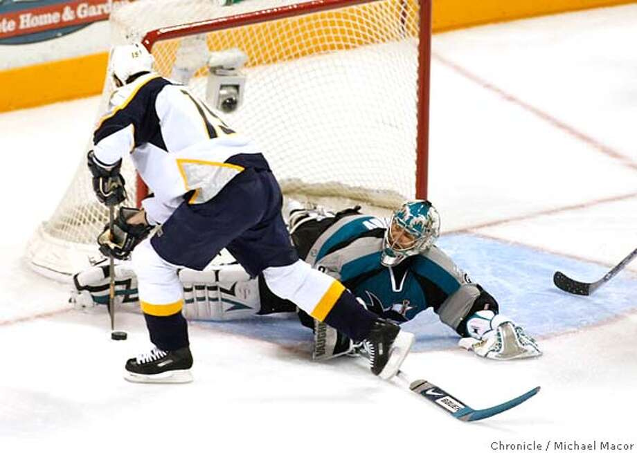 Sharks goalie- Evgenii Nabokov goes one on one with Nashville's 19- JAson Arnott, Nabokov stopped the shot.NHL playoffs between the San Jose Sharks and the Nashville Predators, Game 3 of a best of 7 game series. Photographed in, San Jose, Ca, on 4/16/07. Photo by: Michael Macor/ The Chronicle Photo: Michael Macor