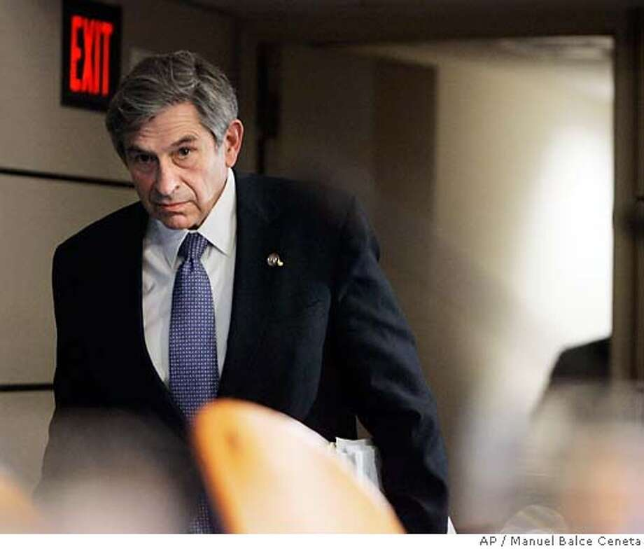 World Bank President Paul Wolfowitz arrives for a news conference at the conclusion of the 2007 Spring meetings at IMF headquarters in Washington, Sunday, April 15, 2007. (AP Photo/Manuel Balce Ceneta) Photo: Manuel Balce Ceneta