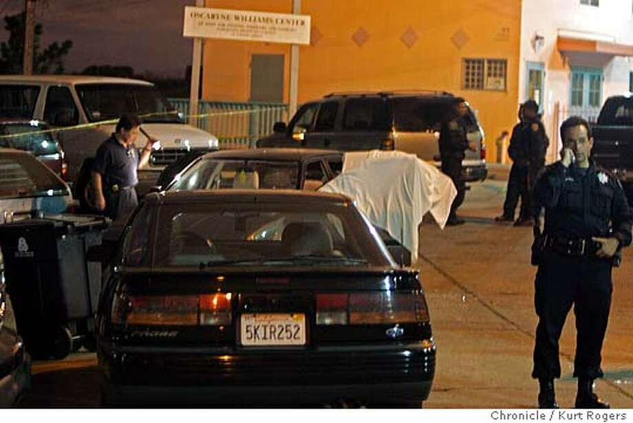 In front of the Oscartne Williams Center on Turner Ter off Missouri St in the Potrero hill area of San Francisco Police investigate a triple shooting. 10/14/05 in San Francisco,CA.  KURT ROGERS/THE CHRONICLE Photo: KURT ROGERS