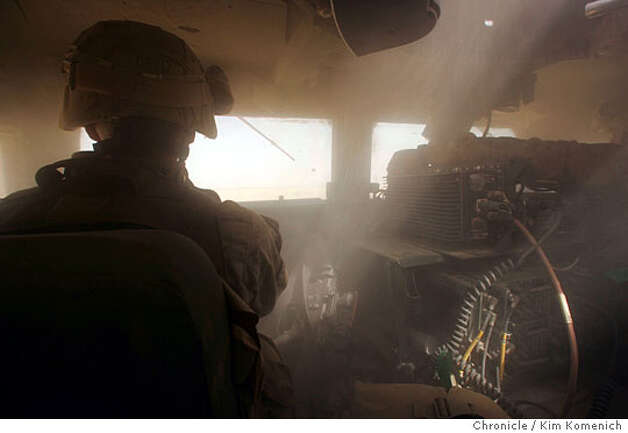 Light streams through the gunner's turret into the powder-fine dust that has crept into the humvee on desert roads to Camp Belleau Wood.  In our first full day reporting, we are taken by Marines from the 1st Mobile Assault Platoon, Weapons Company, 3rd Battalion, 6th Marines Regiment to neighborhoods near the Euphrates River at the Syrian border, where there is major insurgent action. San Francisco Chronicle Photo by Kim Komenich  9/27/05 Photo: Kim Komenich