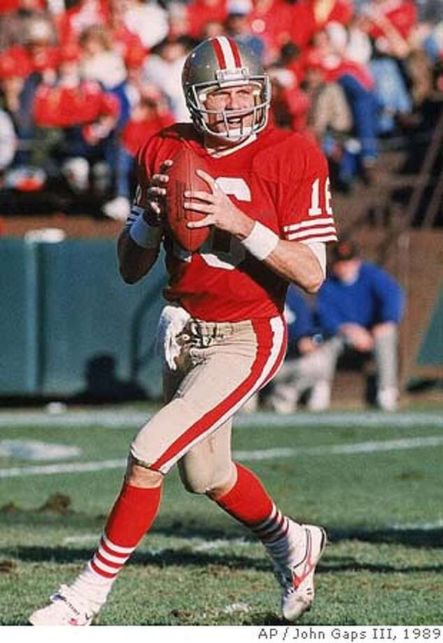 FILE -- San Francisco 49ers quarterback Joe Montana looks downfield for a receiver during the NFC divisional playoff game against the Minnesota Vikings in this Jan. 1, 1989 photo in San Francisco. Montana will be inducted into the Pro Football Hall of Fame during ceremonies in Canton, Ohio Saturday July 29, 2000. (AP Photo/John Gaps III) Ran on: 02-07-2005 Ran on: 02-07-2005 CAT A Jan. 1, 1989 file photo Photo: JOHN GAPS III