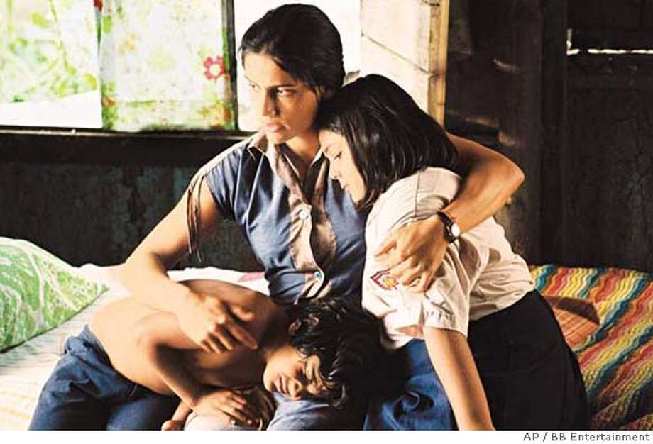 In this photo provided by BB Entertainment, (left to right) Carlos Padilla, Leonor Varela and Ana Paulina Caceres in BB Entertainment's Innocent Voices. (AP Photo/BB Entertainment) Photo: Bb Entertainment