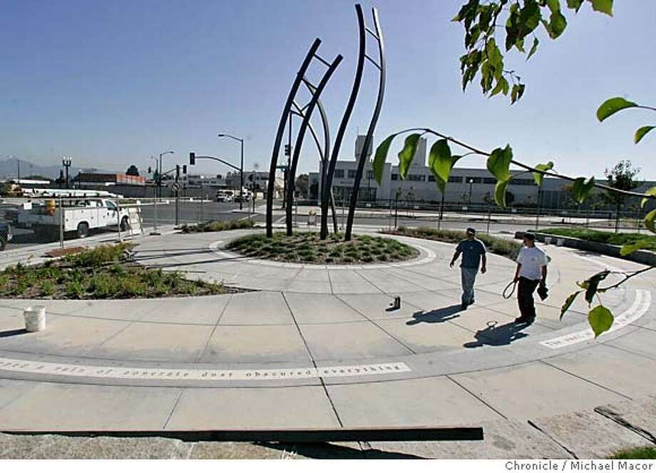 quakememorial_063_mac.jpg : The Oakland Memorial Park to the 1989 Loma Prieta Earthquake sits at the corner of 14th St. and Mandella Parkway. A grassy spot in industrial West Oakland has become a stop on the Bay Trail � and a place to remember the violent collapse of a double-deck freeway that killed 42 people in the Loma Prieta earthquake 16 years ago today (Oct. 17, 1989). The Cypress Freeway Memorial Park will be dedicated at 5:04 p.m., the minute the Earth shook for 15 seconds, as survivors, heroic citizens and public officials officially open what they hope will be a place of tranquility. 10/13/05 in Oakland, {state.} Michael Macor / San Francisco Chronicle Mandatory Credit for Photographer and San Francisco Chronicle/ - Magazine Out Photo: Michael Macor