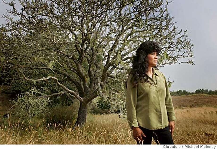 Local Tolowa tribe descendant Candace Penney stands on the site where her ancestors were massacred by white settlers eager to seize the land located around the mouth of the Smith River. Men, women and children were slaughtered by the hundreds. Bodies were pitched into the slough until its waters were stained red. Her grandmother, mother and aunt are all buried in hills above Yontocket Slough. The Yontocket site is now part of Tolowa Dunes State Park. Rediscovering California's North Coast. A kayak voyage by Paul McHugh, Bo Barnes and John Weed. A paddle from the Oregon border to the SF bay.  Photo taken on 8/24/05 in Smith River, CA  Photo by Michael Maloney / San Francisco Chronicle Photo: Michael Maloney