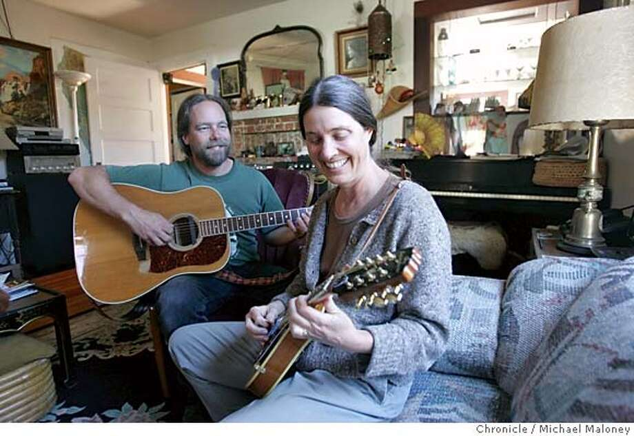NCOAST_PTARENA_086_MJM.jpg  The mayor of Point Arena, Leslie Dahlhoff (right) and her husband Eric Dahlhoff play mandolin and guitar in their livingroom. Rediscovering California's North Coast. A kayak voyage by Paul McHugh, Bo Barnes and John Weed. A paddle from the Oregon border to the SF bay.  Photo taken on 10/4/05 in Point Arena, CA by Michael Maloney / San Francisco Chronicle MANDATORY CREDIT FOR PHOTOG AND SF CHRONICLE/ -MAGS OUT Photo: Michael Maloney