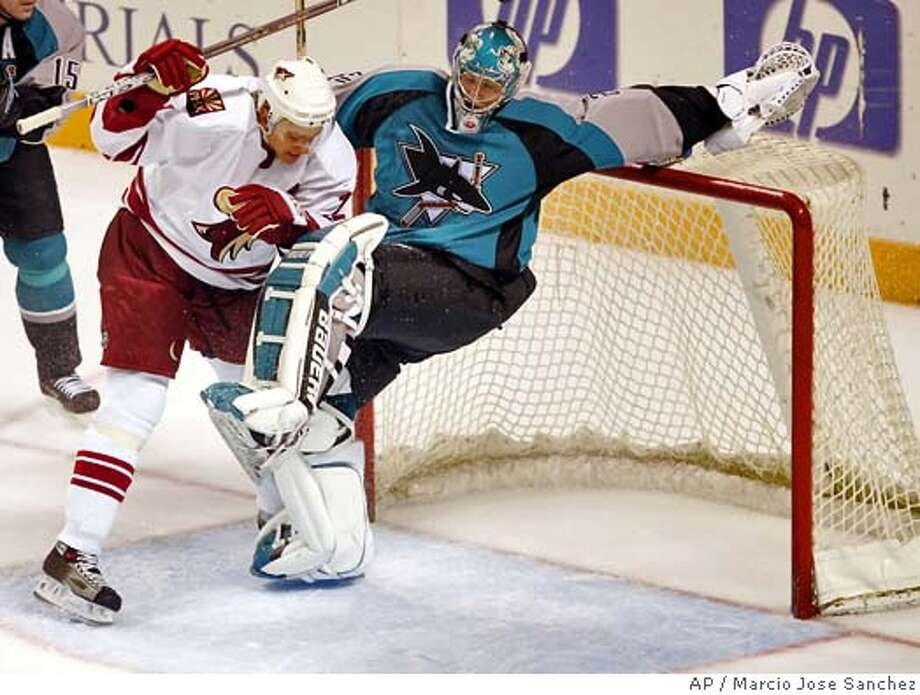 Phoenix Coyotes' Mike Johnson, left, collides with San Jose Sharks goalkeeper Evgeny Nabokov in the second period on Friday, Sept. 30, 2005 in San Jose, Calif. (AP Photo/Marcio Jose Sanchez) Photo: MARCIO JOSE SANCHEZ