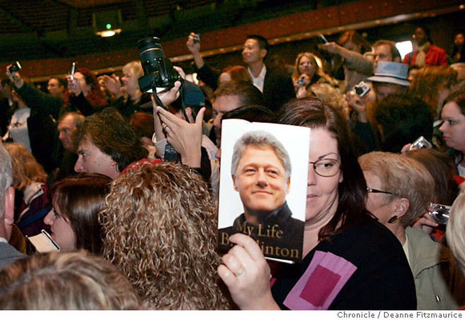 A woman holds Bill Clinton's book, hoping for an autograph. Former President Bill Clinton spoke about health care and the war at KCBS' 3rd Annual Health Fair at Bill Graham Civic Auditorium in San Francisco on 4/14/07. Deanne Fitzmaurice / The Chronicle Photo: Deanne Fitzmaurice