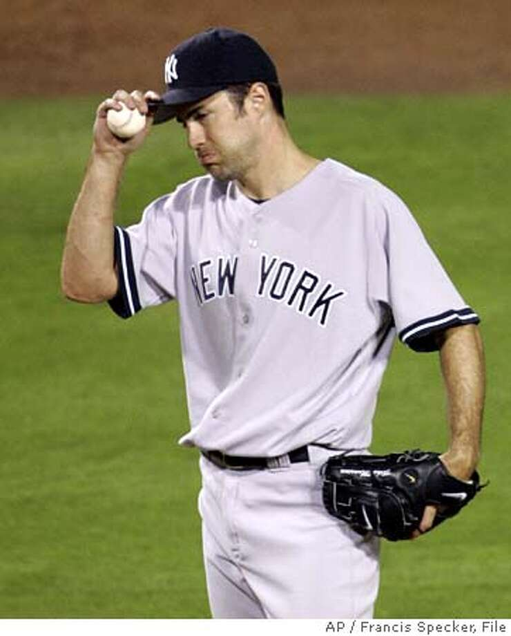 New York Yankees starting pitcher Mike Mussina reacts during the third inning of Game 5 of the American League Division Series against the Los Angeles Angels, Monday, Oct. 10, 2005, in San Diego. Mussina left the game later in the inning. (AP Photo/Francis Specker) Photo: FRANCIS SPECKER