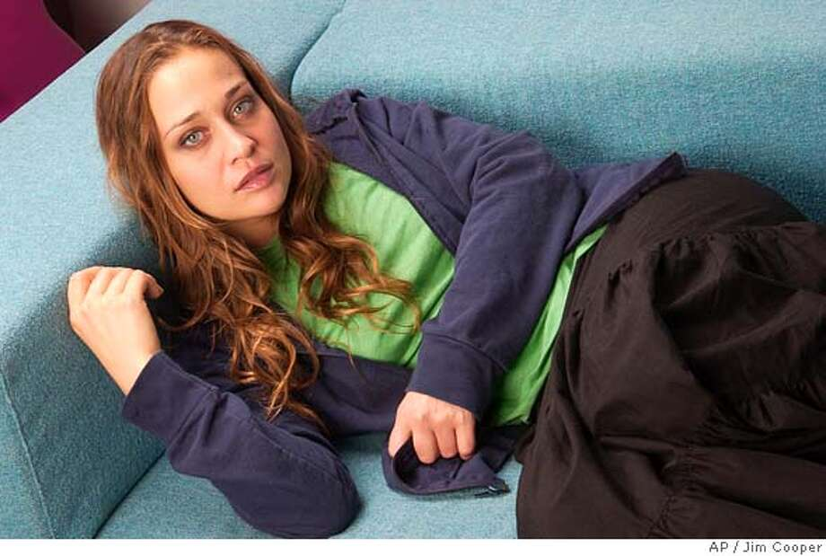 "Singer Fiona Apple is photographed at MTV studios in New York on Sept. 19, 2005. Apple's new album is titled ""Extraordinary Machine."" (AP Photo/Jim Cooper) Photo: JIM COOPER"