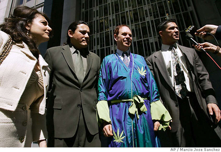 Ed Rosenthal, second from right, is flanked by his attorneys Shari Greenberger, left, Omar Figueroa, second from left, and Robert Amparan, outside of the Federal courthouse in San Francisco, Friday, April 13, 2007. Federal prosecutors said Friday they would retry marijuana grower Ed Rosenthal on cultivation charges, even after a federal judge urged them to drop the case and chastised the government for lodging charges solely to punish the self-proclaimed ''guru of ganja.'' (AP Photo/Marcio Jose Sanchez) Photo: Marcio Jose Sanchez
