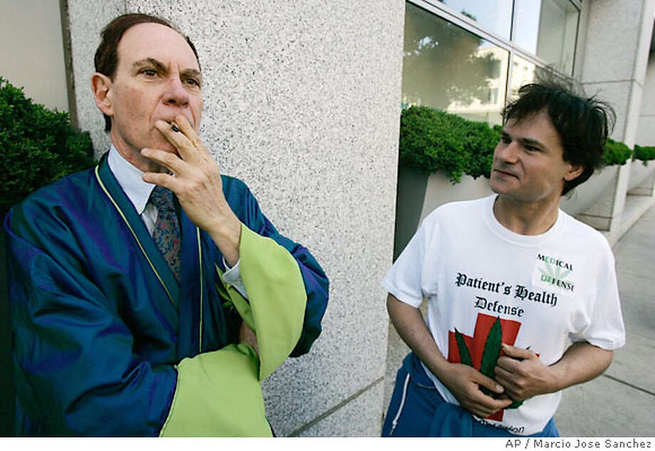 Ed Rosenthal, left, smokes marijuana with supporter David Cohen outside of the federal courthouse in San Francisco, Friday, April 13, 2007. Federal prosecutors said Friday they would retry marijuana grower Ed Rosenthal on cultivation charges, even after a federal judge urged them to drop the case and chastised the government for lodging charges solely to punish the self-proclaimed ''guru of ganja.'' (AP Photo/Marcio Jose Sanchez) Photo: Marcio Jose Sanchez