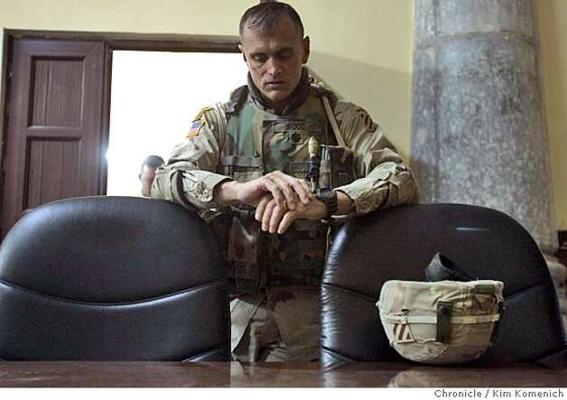 At the Tikrit Joint Communications Center, Lt. Col. Todd Wood pauses about a half an hour before the polls open.  We tour the Tikrit area as the Iraqi consititutional referendum takes place. Our story features two aspects of the referendum: the vote itself, at some of the 33 Tikrit area polling places, and then the backstory- the role of Lt. Col. Todd Wood and soldiers from the 2nd Battalion, 7th Infantry Regiment,1st Brigade of the Third Infantry Division, U.S. Army in making sure the Iraqi Army and Police are ready to support safe and secure elections without direct U.S. help.  San Francisco Chronicle Photo by Kim Komenich  10/15/05 Photo: Kim Komenich
