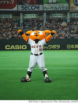 TRAVEL JAPAN BASEBALL -- Giabbit, the mascot of the Yomiuri Giants, performs for the crowd. Bill Fink / Special to the Chronicle  One-time use only with Travel story (SFGate OK if also used in print.)