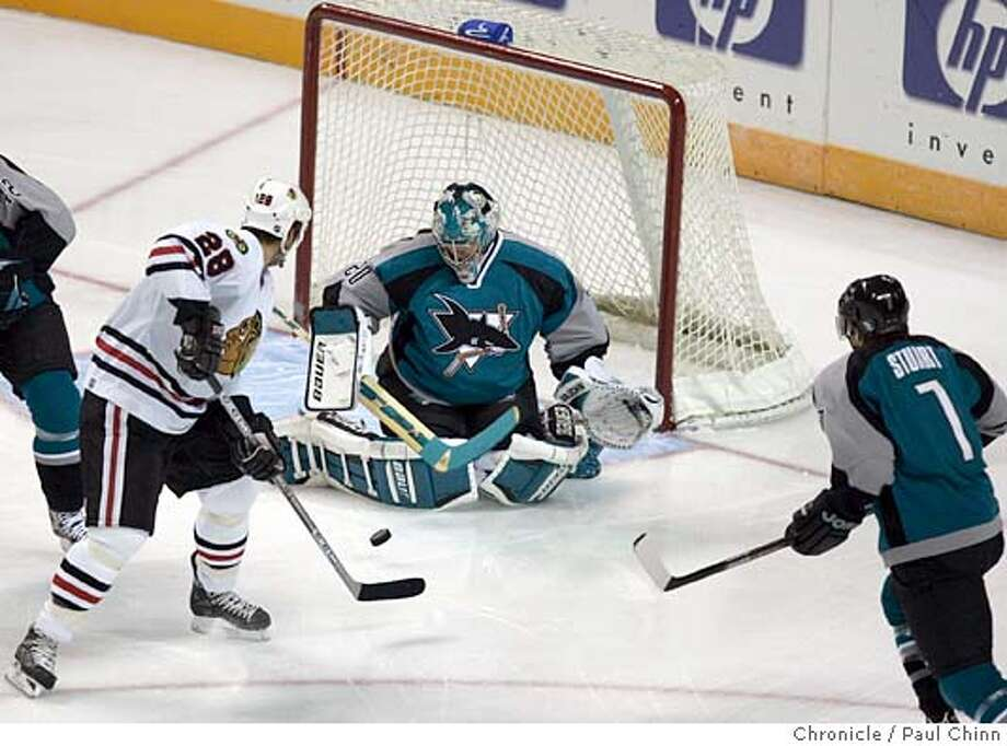 Evgeni Nabokov blocks a shot attempt by Chicago's Mark Bell in the first period of the San Jose Sharks vs. Chicago Blackhawks at HP Pavilion on 10/15/05 in San Jose, Calif.  PAUL CHINN/The Chronicle Photo: PAUL CHINN