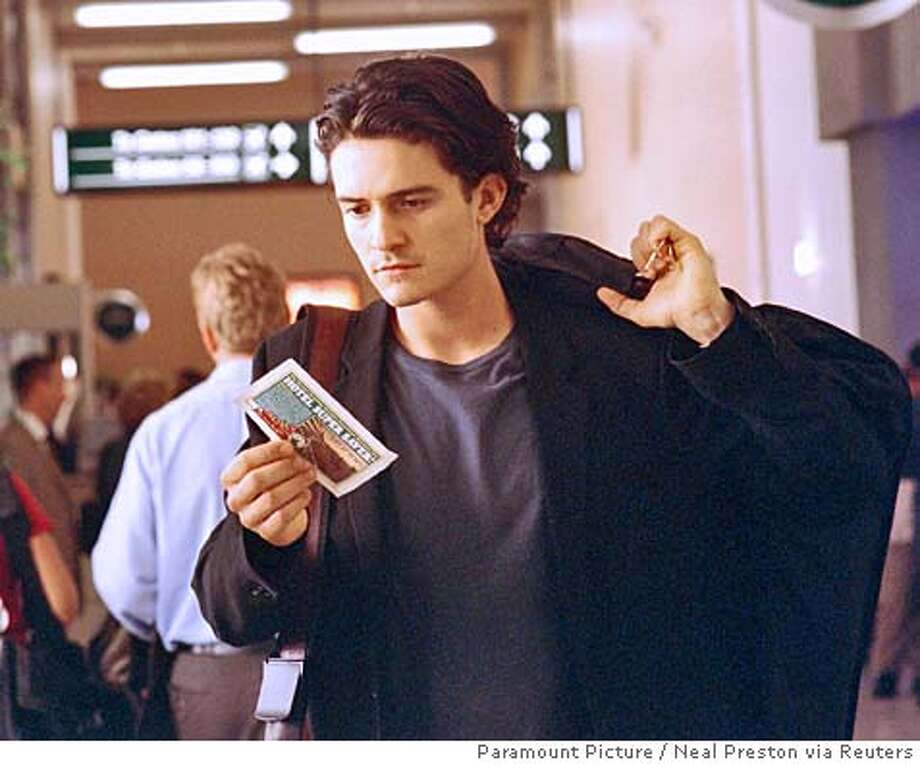 "Drew Baylor (Orlando Bloom) goes back to his Kentucky hometown Elizabethtown in the movie ""Elizabethtown"" in this undated publicity photo released by Paramount pictures in Los Angeles on October 11, 2005. The romantic comedy tells the story of Baylor (Bloom) who after being fired by the Oregon shoe company he works for, dumped by his girlfriend and the death of his father manages to find himself with the help of flight attendant Claire Colburn (Kirsten Dunst). The film opens in the U.S. Friday. NO ARCHIVES REUTERS/Neal Preston/Paramount Pictures/Handout 0 Photo: HO"