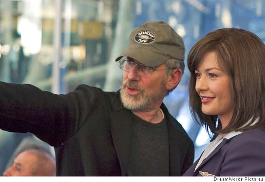 TERMINAL  Director STEVEN SPIELBERG gives some direction to star CATHERINE ZETA-JONES on the set of DreamWorks Pictures� THE TERMINAL. The Terminal Photo: Xcvxcv