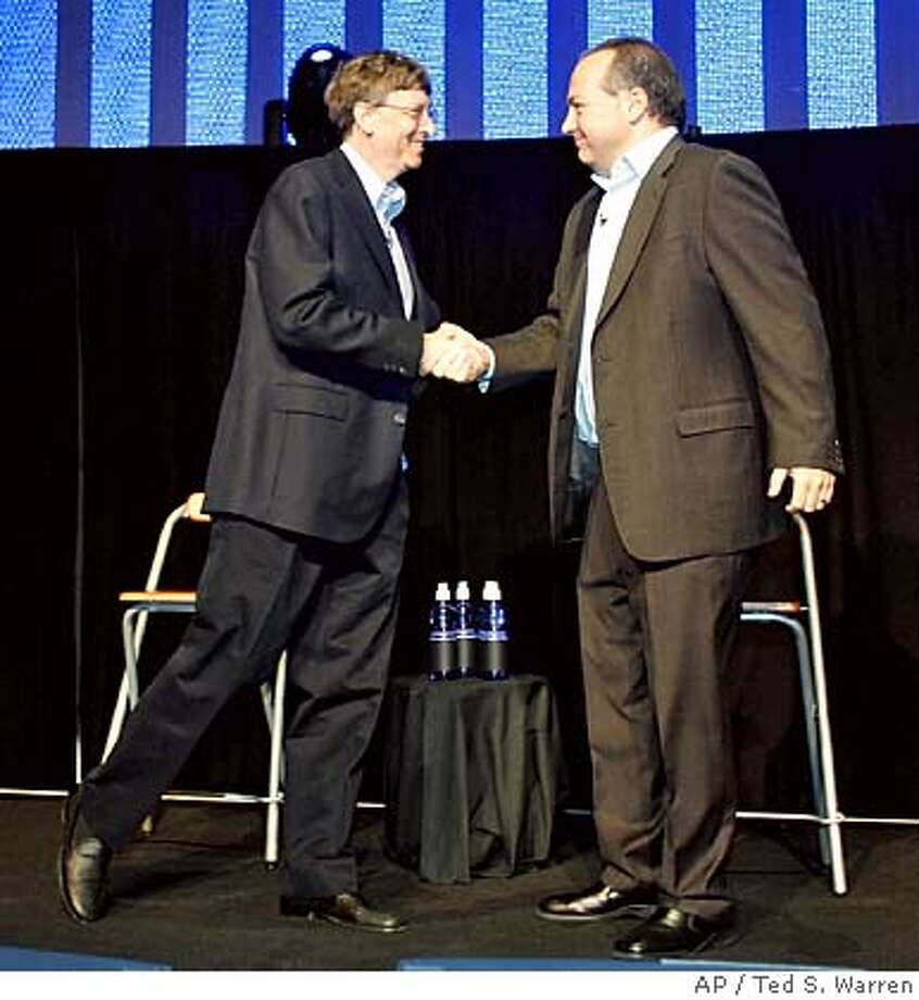 Microsoft Corp. Chairman Bill Gates, left, shakes hands with RealNetworks Inc. Chief Executive Rob Glaser, right, Tuesday, Oct. 11, 2005 in Seattle as they announce that RealNetworks, a digital media pioneer and longtime Microsoft Corp. foe, had reached a broad antitrust settlement with Microsoft worth $761 million. (AP Photo/Ted S. Warren) Photo: TED S. WARREN