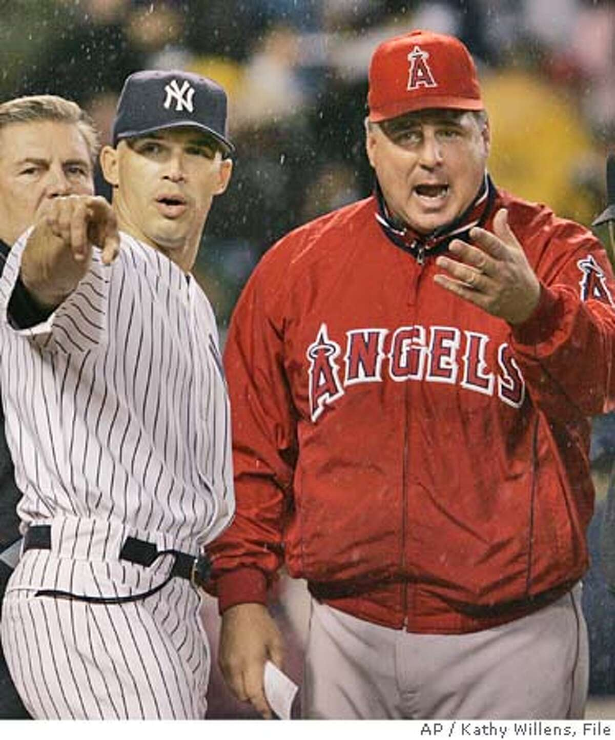 ** FILE ** New York Yankees bench coach Joe Girardi, left, and Anaheim Angels manager Mike Scioscia have a discussion at home plate prior to Game Four of the American League Division Series, Oct. 7, 2005, in New York. Girardi has no managerial experience, which may soon change. The Yankees' bench coach interviewed Wednesday, Oct. 12, 2005 in New York with two teams seeking a manager: the Florida Marlins and Tampa Bay Devil Rays. (AP Photo/Kathy Willens)