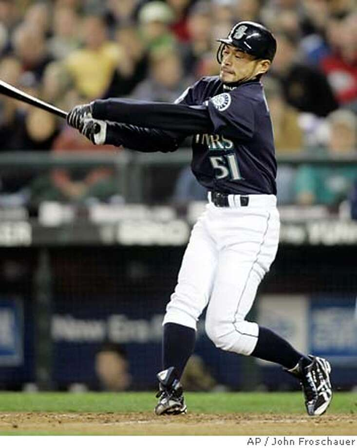 Seattle Mariners' Ichiro Suzuki strikes out against the Texas Rangers during the seventh inning of their baseball game in Seattle Friday, April 13, 2007. Suzuki had no hits and one walk in the 5-2 loss to the Rangers. (AP Photo/John Froschauer) Photo: John Froschauer