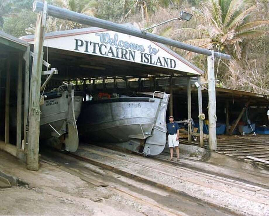 Travel Pitcairn: Longboats are a lifeline for remote Pitcairn Island, which is hoping to increase tourism.  photo credit: Jeff Stockmap/courtesy Pitcairn Island