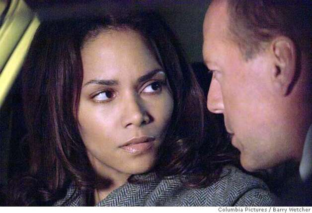 "This photo provided by Columbia Pictures shows Halle Berry and Bruce Willis in a scene from ""Perfect Stranger."" (AP Photo/Columbia Pictures/Barry Wetcher) NO SALES. NO MAGS. Photo: Barry Wetcher"