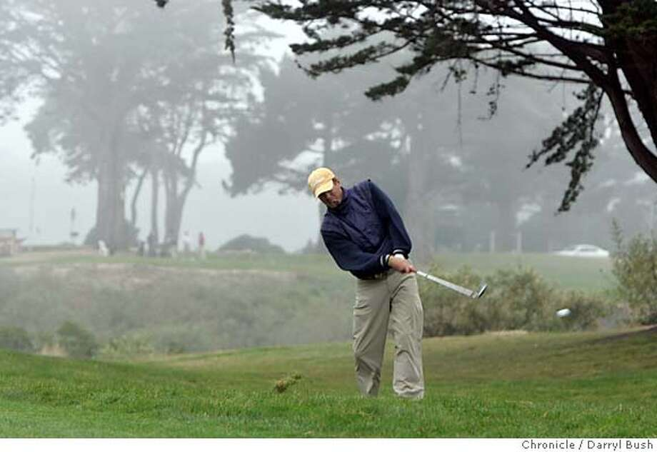 hardingpark_0018_db.jpg  Pete Johnson of San Francisco, hits from the rough on the 18th hole as muni golfers return to play at Harding Park Golf Course.  Event on 10/12/05 in San Francisco.  Darryl Bush / The Chronicle MANDATORY CREDIT FOR PHOTOG AND SF CHRONICLE/ -MAGS OUT Photo: Darryl Bush