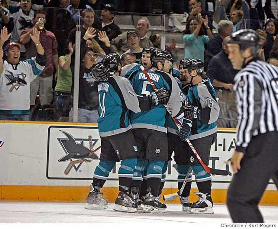 The Sharks celebrate the second goal by Wayne Primeau in the first.  The San Jose Sharks vs the Columbus Blue Jackets SHARKS_0390_kr.JPG 10/12/05 in San Jose,CA.  KURT ROGERS/THE CHRONICLE MANDATORY CREDIT FOR PHOTOG AND SF CHRONICLE/ -MAGS OUT Photo: KURT ROGERS