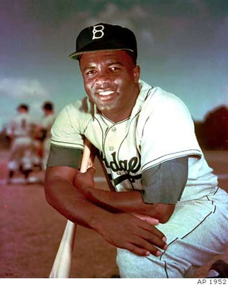 Jackie Robinson helped the Dodgers win six NL pennants in his 10 seasons with Brooklyn. Associated Press photo, 1952