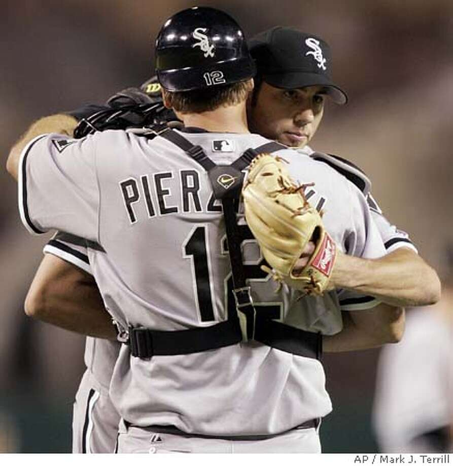 Chicago White Sox pitcher Jon Garland is congratulated by catcher A.J. Pierzynski after winning Game 3 of the American League Championship Series against the Los Angeles Angels, Friday, Oct. 14, 2005, in Anaheim, Calif. Garland pitched nine innings for the 5-2 win. (AP Photo/Mark J. Terrill) Ran on: 10-15-2005  Jon Garland is congratulated by A.J. Pierzynski after the final out of his complete-game victory. Photo: MARK J. TERRILL