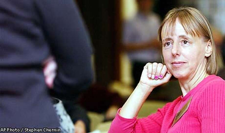 Medea Benjamin, founder of Global Exchange, listens to a speaker at the United Nations Correspondents Association club, Thursday, Oct. 24, 2002, at U.N. headquarters in New York. (AP Photo/Stephen Chernin) Photo: STEPHEN CHERNIN