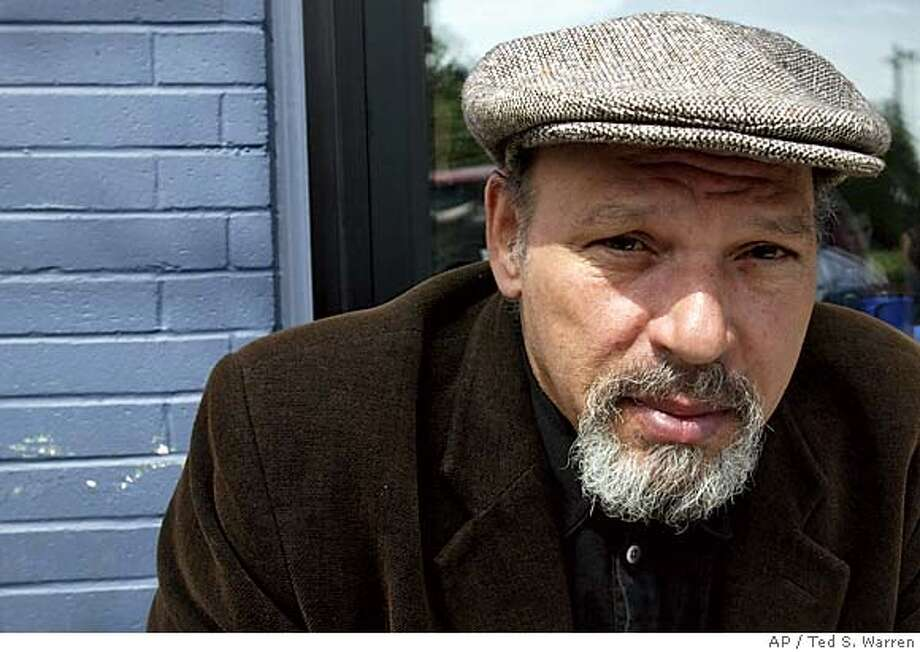 "** FILE ** Pulitzer Prize-winning playwright August Wilson poses during a visit to a coffee shop Friday, May 30, 2003, in his Seattle neighborhood. Wilson, whose epic 10-play cycle chronicling the black experience in 20th-century America included such landmark dramas as ""Fences"" and ""Ma Rainey's Black Bottom,"" died Sunday Oct. 2, 2005 of liver cancer, a family spokeswoman said. He was 60. (AP Photo/Ted S. Warren) Photo: TED S. WARREN"
