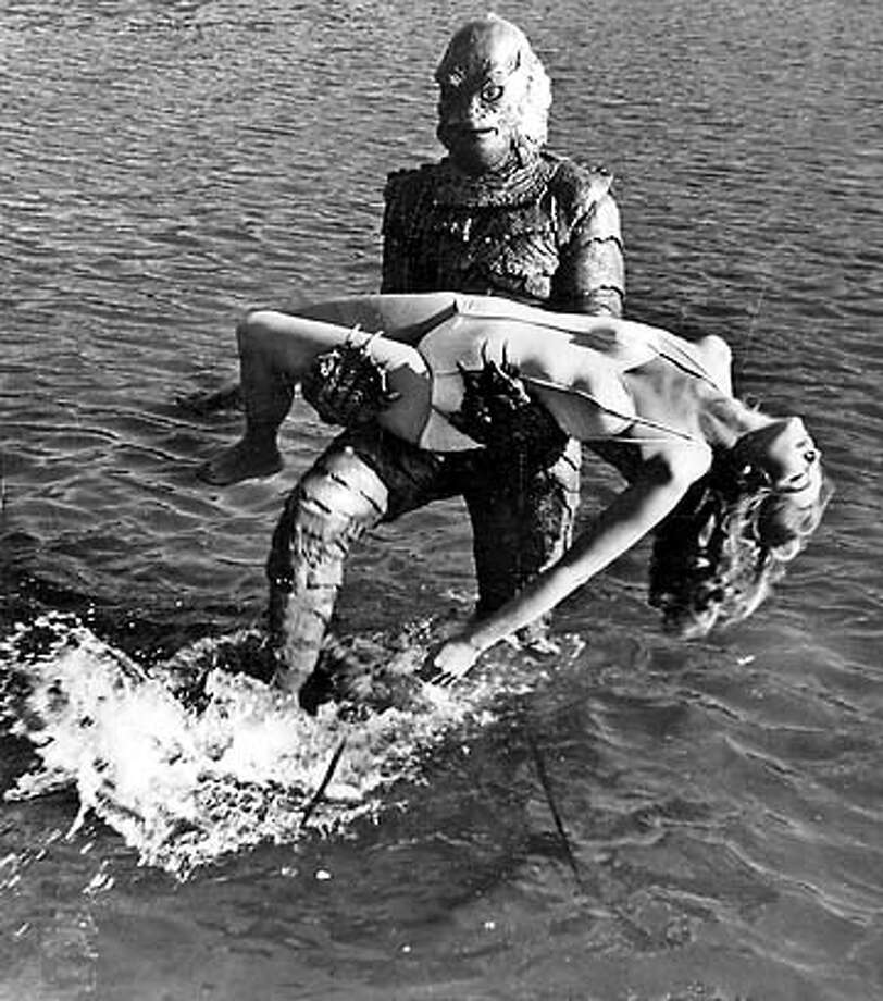 "The Gill Man mask worn by Ricou Browning from the underwater film sequences in ""Creature from the Black Lagoon."" Above, a still from the film. Photo: -"
