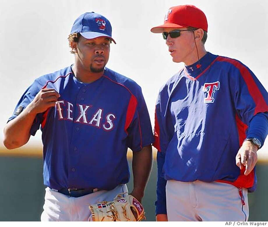 Texas Rangers pitcher Francisco Cordero talks with pitching coach Orel Hershiser during a simulated game at spring training in Surprise, Ariz., Monday, March 14, 2005. It was the first time the closer has faced batters this spring. (AP Photo/Orlin Wagner) Ran on: 03-20-2005  Rangers pitcher Francisco Cordero (left) talks with pitching coach Orel Hershiser during a simulated game in spring training. The Rangers are confident Cordero will be ready on Opening Day. Photo: ORLIN WAGNER
