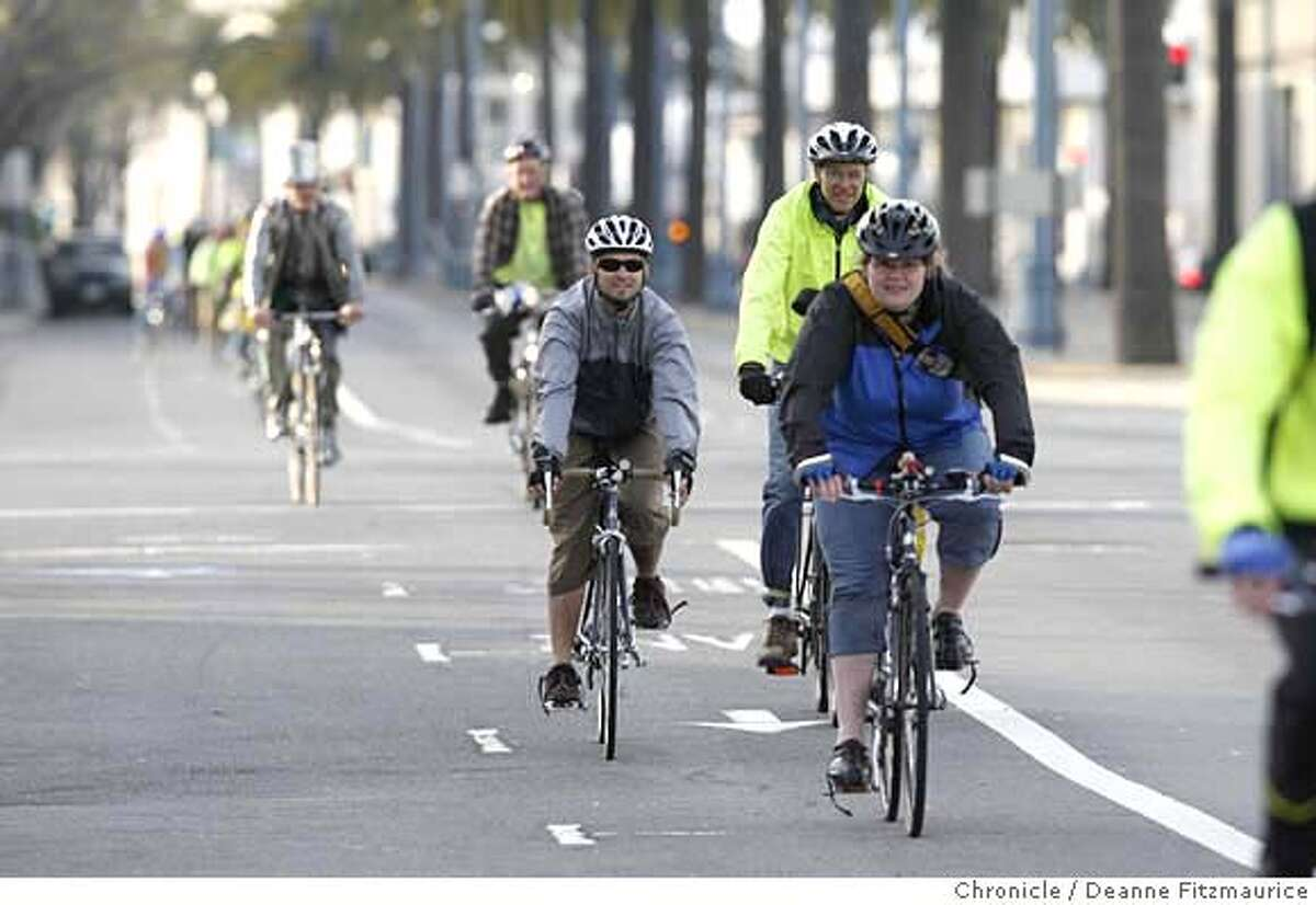 Bike riders ride in a bike lane along the Embarcadero as they take part in Critical Manners, a polite alternative to Critical Mass bike ride in San Francisco on 4/13/07. Deanne Fitzmaurice / The Chronicle