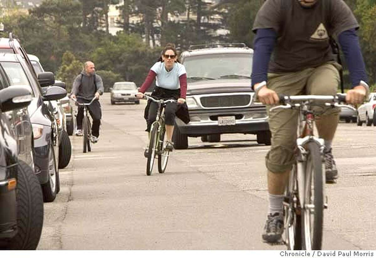 SAN FRANCISCO,- APRIL 29: Bicyclists make their way between the cars along JFK drive in Golden Gate Park on April 29, 2006 in San Francisco, California. (Photo by David Paul Morris/The Chronicle)Ran on: 05-01-2006 Bicyclists twist their way in traffic on John F. Kennedy Drive in Golden Gate Park on Saturday, when close calls are a peril.Ran on: 05-01-2006 Bicyclists twist their way in traffic on John F. Kennedy Drive in Golden Gate Park on Saturday, when close calls are a peril.