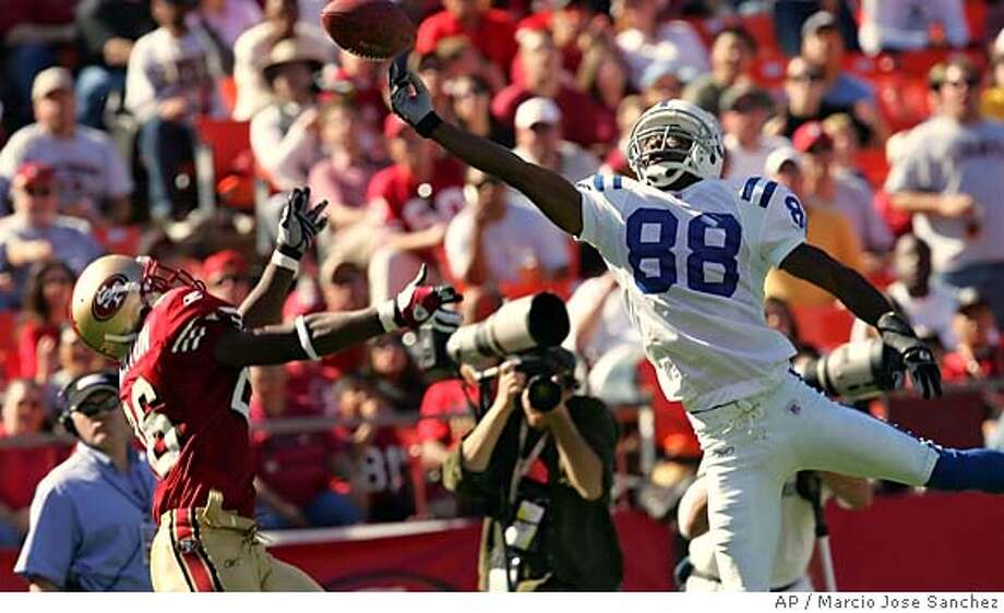 indianapolis Colts' Wide Receiver Marvin Harrison (88) misses a pass in the end zone as the San Francisco 49ers' Bruce Thornton, left, prepares to intercept the ball in the third quarter on Sunday, Oct. 9, 2005, in San Francisco. (AP Photo/Marcio Jose Sanchez) Photo: MARCIO JOSE SANCHEZ