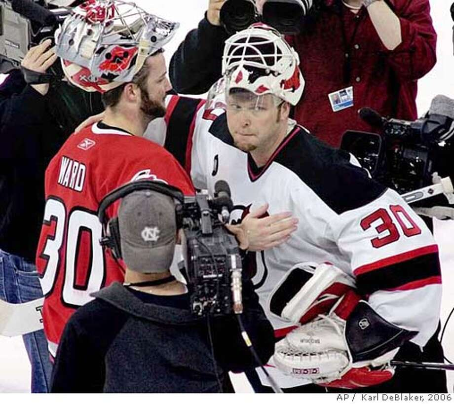 New Jersey Devils goaltender Martin Brodeur, right, congratulates Carolina Hurricanes goaltender Cam Ward, left, following the Hurricanes' 4-1 win to advance to the Eastern Conference finals, Sunday, May 14, 2006, in Raleigh, N.C. (AP Photo/ Karl DeBlaker) Ran on: 05-15-2006  Carolina goalie Cam Ward meets his counterpart, New Jersey goalie Martin Brodeur, whose team was eliminated.  Ran on: 05-15-2006 Ran on: 05-15-2006 EFE OUT Photo: KARL DEBLAKER