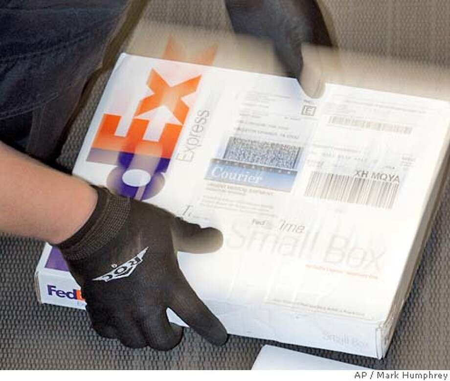 A package is sorted at the FedEx express station in Nashville, Tenn., on Wednesday, March 21, 2007. FedEx Corp. said a slowing economy, severe winter storms and lower fuel surcharges contributed to a 2 percent decline in its fiscal third-quarter profit. Its shares fell nearly 2 percent. (AP Photo/Mark Humphrey) Photo: Mark Humphrey