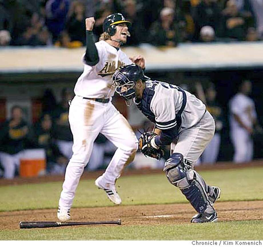 ATHLETICS316_KK.JPG  TRAVIS BUCK CELEBRATES AFTER JORGE POSADA CAN'T MAKE THE TAG, SCORING THE WINNING RUN AFTER A BOBBY KIELTY HIT IN THE BOTTOM OF THE 11TH. as the A's beat the Yankees 5-4 at the Coliseum Friday.  Photo by Kim Komenich/The Chronicle Photo: Kim Komenich